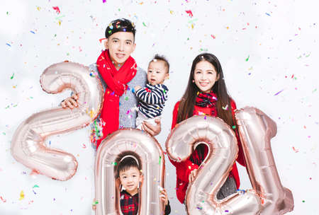 happy family wearing warm clothes on white background. and Winter vacation concepts Stock fotó