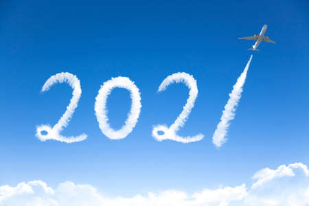 happy New year 2021 concept. cloud drawing by airplane in sky