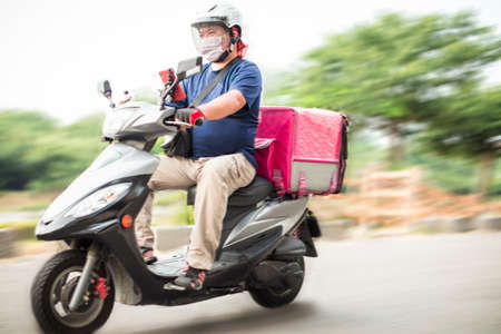 food delivery staff ride motorcycles to deliver food