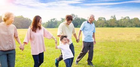 three generation asian family walking in the park Reklamní fotografie