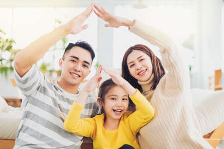 Happy family with daughter playing at home