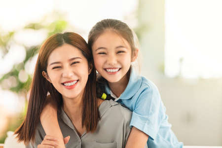 Happy mother and little girl daughter having fun at home Imagens