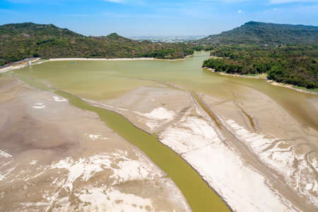 Aerial view of partly dry lake bed. Dry and cracked ground. Taiwan