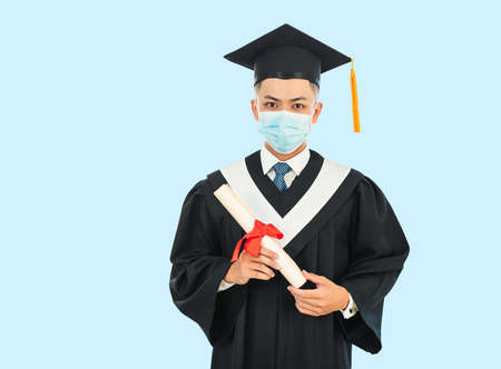 young male graduation wearing face mask during the  pandemic Stok Fotoğraf
