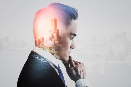 Double exposure of businessman and city view concept