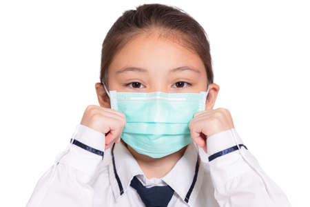 Girl in a medical mask.Isolated on white background. Фото со стока