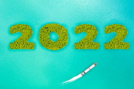 Aerial view new year 2022 island concepts and cargo ship on the sea