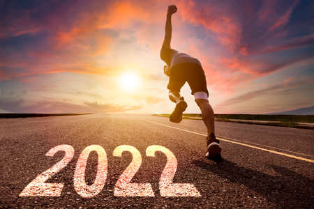 Man running and sprinting on road with 2022 new year concept