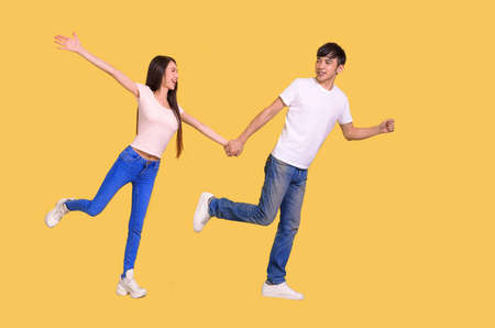 side view of happy young couple running