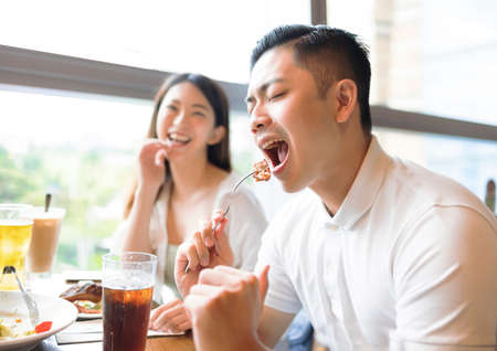 Happy couple having fun during lunch in restaurant