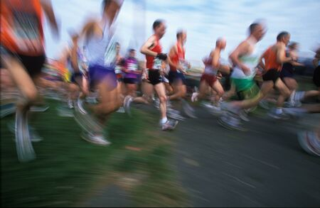 Field of runners in the April 2002 London Marathon with motion blur and copyspace on the ground Stock Photo - 19710974