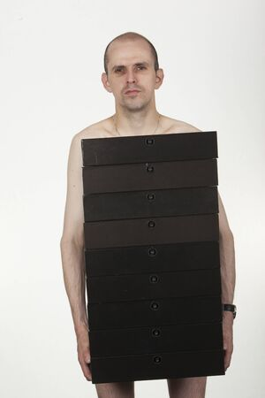 Conceptual image of a naked man holding many folders and hiding private parts.