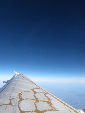 above the clouds: plane window