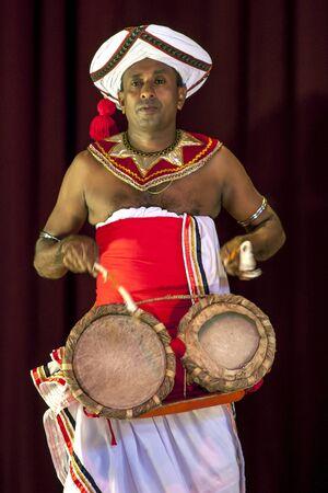 kandy: A Thammattam Player performs at the Esala Perahera Theatre Show in Kandy in Sri Lanka.