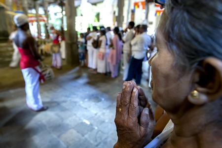 kandy: A lady offers prayers at the in Kandy, Sri Lanka.