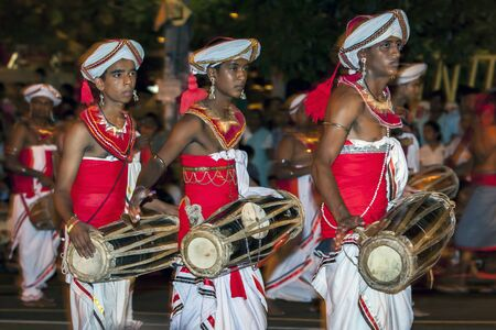 reciting: Gatabera Players perfom infront of huge crowds lining the streets of Kandy during the Esala Perahara in Kandy, Sri Lanka. The Gatabera players are considered the most skillful of drummers and the rhythm of their beat whilst reciting verses is seen as an o