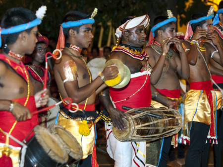 colourfully: A group of musicians perform through the streets of Kandy, Sri Lanka during the Esala Perahera. Editorial