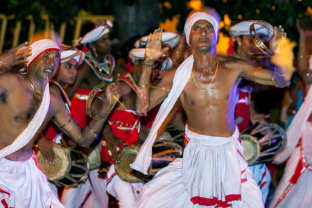 vigorous: Tamerine Players perform to the beat of Getabera drummers along the streets of Kandy during the Esala Perahara. Their playing is accompanied by a dance of vigorous short steps.