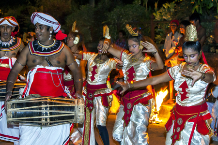 kandy: Dancers and Gatabera Players prepare to participate in the Esala Perahara in Kandy, Sri Lanka.