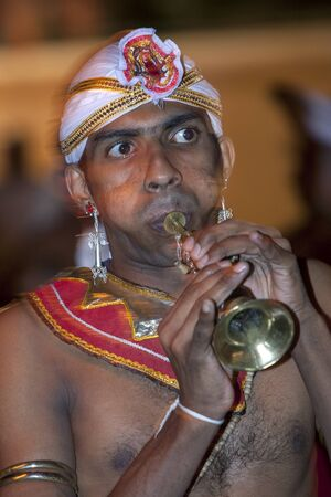 trumpet player: A trumpet player performs during the Esala Perahera in Kandy, Sri Lanka.
