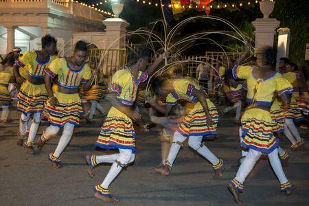 weavers: Ratten Weavers perform along the streets of Kandy during the Esala Perahera. Sri Lanka. Editorial