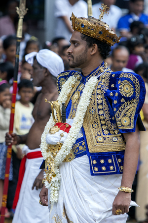 kandy: A Temple Priest walks through the streets of Kandy during the daytime Perahera. Sri Lanka. Editorial