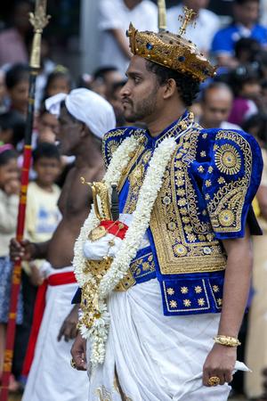 sri lanka temple: A Temple Priest walks through the streets of Kandy during the daytime Perahera. Sri Lanka. Editorial