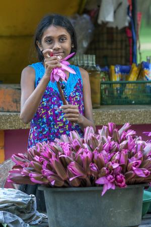 southern sri lanka: A girl selling lotus flowers at Kataragama temple complex in southern Sri Lanka.