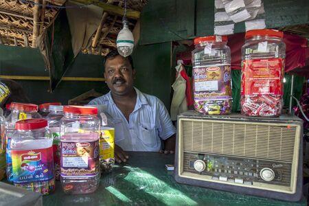 shop keeper: A Sri Lankan shop keeper near Kataragama in Sri Lanka.