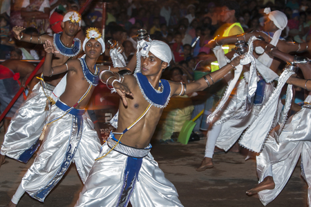 supposed: Dance of Kothala or Kothala Padhaya performers at the Esala Perahera in Kandy, Sri Lanka. The dancers carry a pot of Pirith water blessed water which not only symbolises prosperity but the water is supposed to have a healing power in Sinhala culture. The