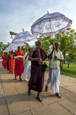 2nd century: Buddhist monk pilgrims to Anuradhapura carry offerings towards the 2nd Century BC Ruwanwelisiya Dagoba. Sri Lanka.