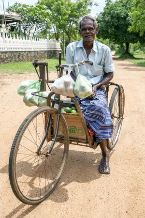 sigiriya: A man on his way home after buying fruit at a local market in Sigiriya, Sri Lanka. Editorial