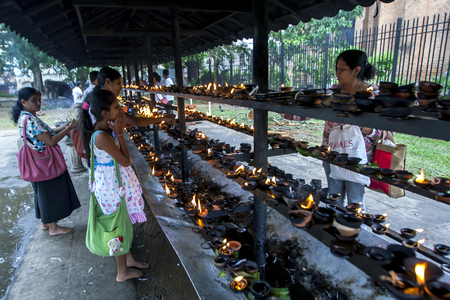 kandy: Worshippers light oil lamps within the Temple of the Sacred Tooth Relic in Kandy, Sri Lanka during the Kandy Festival.