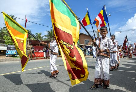 sri lankan flag: Flag Carriers walking with the Sri Lankan flag during the Hikkaduwa Perahara. Editorial
