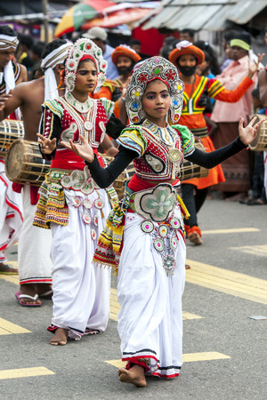 colourfully: Colourfully dressed dancers perform through the streets during the Hikkaduwa Perahara on the east coast of Sri Lanka.