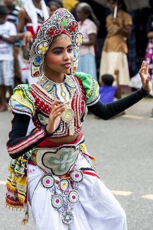 colourfully: A colourfully dressed dancer performs through the streets during the Hikkaduwa Perahara on the east coast of Sri Lanka. Editorial