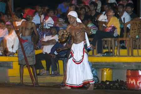 lord buddha: A Tamerine Player Pantherukaruwo performs along the streets of Kandy during the Esala Perahara in Sri Lanka. The Esala Perahera is held to honour the Sacred Tooth Relic of Lord Buddha which is enshrined within the Temple of the Sacred Tooth Relic and is c