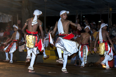 kandy: Pathuru Dancers perform at the Esala Perahera in Kandy, Sri Lanka. The Esala Perahera is held to honour the Sacred Tooth Relic of Lord Buddha which is enshrined within the Temple of the Sacred Tooth Relic and is considered one of the most colourful proces Editorial