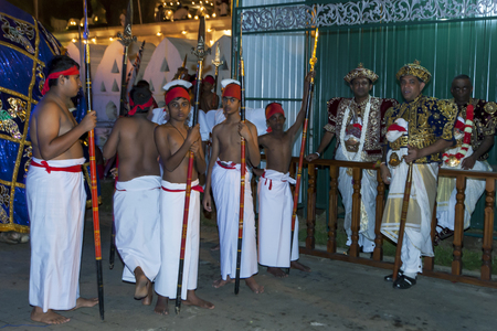sri lanka temple: Temple Priests and their attendants prior to the start of the Esala Perahera in Kandy. Sri Lanka. The Esala Perahera runs every year in late July or early August for ten days, ending on the Nikini poya full moon and is held to honour the Sacred Tooth Reli Editorial
