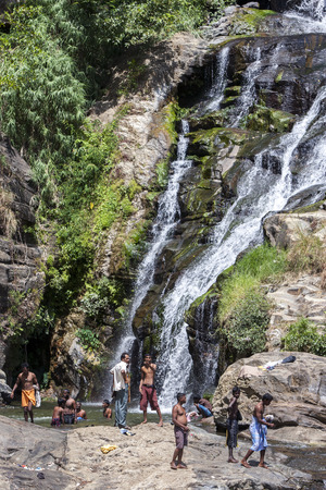 bathers: Bathers cool off at the base of Ella Waterfall near Tissamaharama in Sri Lanka. Editorial