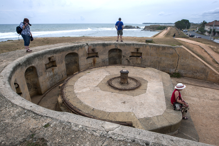 galle: Tourists relaxing around the Triton Bastion which forms part of the remants of the once mighty Galle fort in Sri Lanka. Editorial
