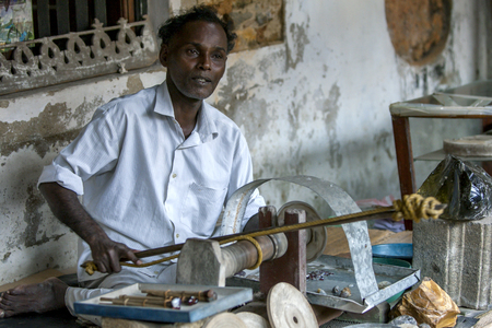 galle: A man demonstrates how to polish gemstones at the  Galle Fort Museum at Galle, Sri Lanka. Editorial