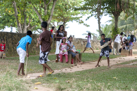 galle: Children enjoy a game of cricket near Akersloot Bastion at Galle Fort in Sri Lanka.