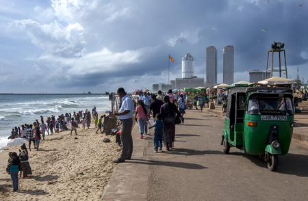 approaches: Vicitors to Galle Face Green enjoy a sunny afternoon along the Indian Ocean as a storm approaches. Colombo, Sri Lanka.