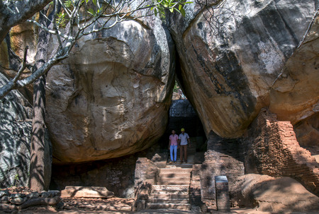 sigiriya: Visitors to Sigiriya Rock walk through Boulder Arch Number One. This pathway leads from the Royal Gardens to the the summit of Sigiriya Rock and it is believed that it was constructed by King Kassapa between 477 to 485AD. Editorial