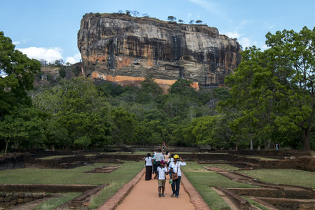 sigiriya: Visitors to Sigiriya Rock walk through the former Royal Gardens which were elaborately designed stone and brick structures built by King Kassapa from 477 to 485AD.