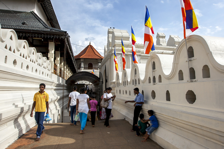 pyre: Visitors to the Temple of the Sacred Tooth Relic, Kandy, Sri Lanka.This temple holds the Sacred Tooth Relic which is believed to be a tooth belonging to Lord Buddha which was obtained from his funeral pyre. Editorial