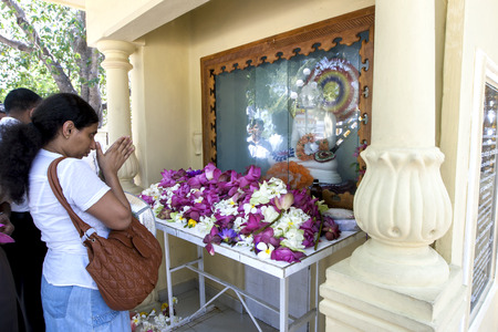 worshipping: Worshippers pray towards a Buddha statue at Naga Pooshani Amman Kovil on Nainativu Island, in the Jaffna region of Sri Lanka.