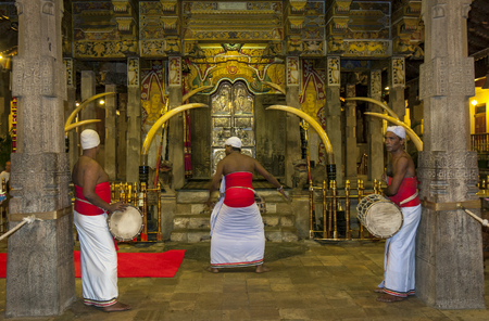 lord buddha: A Buddhist ceremony with Sri Lankan drummers taking place infront of the The PatamalayaLower Storey within the Temple of the Sacred Tooth Relic in Kandy in Sri Lanka.  This temple is where the Sacred Tooth Relic of Lord Buddha is placed when not on displa