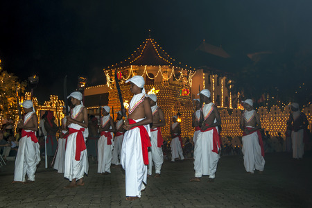 carriers: Sword Carriers perform during the Esala Perahera in Kandy, Sri Lanka. The Esala Perahera runs every year in late July or early August for ten days, ending on the Nikini poya full moon and is held to honour the Sacred Tooth Relic of Lord Buddha which is en